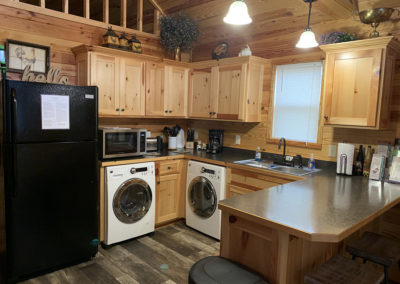 Cabin one kitchen with washer and dryer